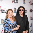 Gene Simmons attends Heroes For Heroes: Los Angeles Police Memorial Foundation Celebrity Poker Tournament at Avalon Hollywood on November 10, 2018 in Los Angeles, California - 425 x 600