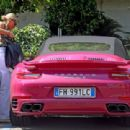 Michelle Hunziker – Spotted at her pink porsche in Milan - 454 x 310