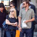 A smitten looking Dakota Fanning and her boyfriend Jamie Strachan go hand in hand for a stroll around New York City - 362 x 594