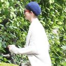 Anne Hathaway is all smiles as she stops by a friends house in Beverly Hills, California on April 18, 2014