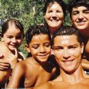 Shirtless Cristiano Ronaldo snaps a sweet selfie with his mini-me son Cristiano Jr as he enjoys some family time in the sun