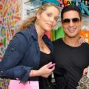 Elizabeth Berkley shows off her dance moves with former Saved By The Bell co-star Mario Lopez