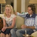Surrogate Angie (AMY POEHLER) and husband Carl (DAX SHEPARD) charm their client.