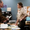 Tommy Lee Jones as Hank and Charlize Theron as Det. Emily in Warner Independent Pictures' In the Valley of Elah.
