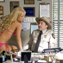 JESSICA SIMPSON as Daisy Duke seduces MICHAEL WESTON as Deputy Enos Strate in Warner Bros. Pictures' and Village Roadshow Pictures' action comedy 'The Dukes of Hazzard,' also starring Johnny Knoxville and Seann William Scott and distribute - 454 x 302