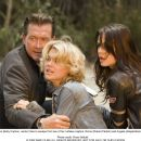 Kate Triton (Kelly Carlson, center) tries to escape from two of her ruthless captors, Rome (Robert Patrick) and Angela (Abigail Bianca) in THE MARINE. Photo credit: Vince Valitutti