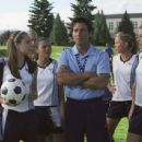 After finding out the girls' soccer team has been unceremoniously cut, the team's star player, Viola (Amanda Bynes, left front), and her teammates ask Coach Pistonek (Robert Torti, center) for a chance to try out for the boys' team - 454 x 280