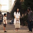 Left to Right: Xu Jiao as Dicky Chow, Kitty Zhang as Miss Yuen and Stephen Chow as Ti Chow. © 2007 Star Overseas Group, Courtesy Sony Pictures Classics. All Rights Reserved.