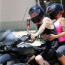 Amber Rose and Machine Gun Kelly Riding Her Can-Am Spyder RS Roadster bike in Los Angles, California - June 23, 2015