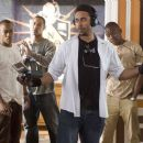 Director Sylvain White (center right), Columbus Short (left) and Brian J. White (center left) on the set of Screen Gems' Stomp the Yard. Photo by: Alfeo Dixon ©2006 Screen Gems, Inc. All rights reserved.