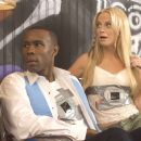 Wood Harris as Dion Warner and Amy Poehler as Veronica Mung in Richard Kelly's SOUTHLAND TALES.