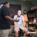 Cedric the Entertainer and Lucy Liu discuss a scene with Director Les Mayfield on the set of New Line Cinema's upcoming comedy, Code Name: The Cleaner. Photo Credit: ©2005 Annabel Reyes/New Line Productions