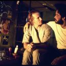 William Hurt as Luis Molina with Raul Julia as Valentin Arregui in City Lights Pictures' Kiss of the Spider Woman.