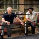 Clint Eastwood as Frankie and Morgan Freeman as Scrap in Warner Bros. Pictures' drama Million Dollar Baby. The Malpaso production also stars Hilary Swank. Merie W. Wallace