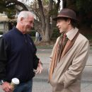 "Producer JERRY WEINTRAUB with TATE DONOVAN as Carson Drew on the set of Warner Bros. Pictures' and Virtual Studios' family mystery adventure ""Nancy Drew,"" distributed by Warner Bros. Pictures. Photo by Melinda Sue Gordon"