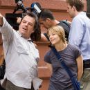 "Director NEIL JORDAN and JODIE FOSTER as Erica Bain during filming of Warner Bros. Pictures' and Village Roadshow Pictures' psychological thriller ""The Brave One,"" distributed by Warner Bros. Pictures. Photo by Abbot Genser"