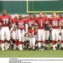 """'(L-R) Jamal Duff, Morris Chestnut, Madison Pettis, Dwayne 'The Rock' Johnson, Hayes MacArthur and Brian White in """"THE GAME PLAN"""" © Disney Enterprises, Inc. All rights reserved. Photo Credit: RON PHILLIPS."""