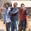"""(Left to right) Chris Rock as Caretaker, Burt Reynolds as Nate Scarborough and Adam Sandler as Paul Crewe in """" The Longest Yard."""" Photo by: Tracy Bennett"""