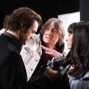 Jim Carrey (left), Director Joel Schumacher (center) and Virginia Madsen (right) discuss the set-up of a shot on the set of THE NUMBER 23. Photo Credit: ©2007 Christine Loss/New Line Cinema - 454 x 303