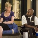 Working girl Angie (AMY POEHLER) confides in doorman Oscar (ROMANY MALCO).