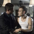 Sebastian Spence and Chad Allen in a scene of Shock to the System - 2006