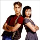 Jason Priestley as Brandon Walsh and Shannen Doherty as Brenda Walsh in Beverly Hills,90210 (1990)