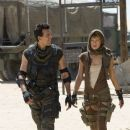Oded Fehr (left) and Milla Jovovich star in Screen Gems' action/horror film RESIDENT EVIL: EXTINCTION. Photo by: Van Redin