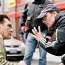 Eugene Levy (left) discusses a take with director Les Mayfield in New Line Cinema's upcoming odd couple action comedy, THE MAN. ©2005 Ava Gerlitz/New Line Productions