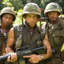 """(Left to right) Alpa Chino (Brandon T. Jackson), Tugg Speedman (Ben Stiller) and Kirk Lazarus (Robert Downey Jr.) are actors shooting a war movie who get caught up in a real battle in the action comedy """"Tropic Thunder."""" Credit: Merie Weismille"""