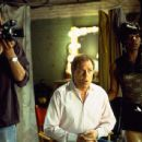 Cameraman (Damien Young), Dwain (Michael McKean) and Peaches (Dwight Ewell) in Universal's The Guru - 2003