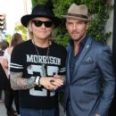Drummer Matt Sorum (L) and Singer Matt Goss attend the 11th Annual John Varvatos Stuart House Benefit at John Varvatos on April 13, 2014 in Los Angeles, California.