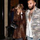 Ashley Benson in Animal Print Coat – Leaving her hotel in Paris