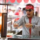 In Columbia Pictures' You Don't Mess with the Zohan, John Turturro (pictured) plays Phantom, a famous (and blinged-out) Palestinian terrorist. Photo By:  Tracy Bennett. © 2008 Columbia Pictures Industries, Inc. All rights reserved.