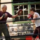 Clint Eastwood as Frankie and Hilary Swank as Maggie in Warner Bros. Pictures' drama Million Dollar Baby. The Malpaso production also stars Morgan Freeman. Merie W. Wallace