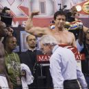 Mason Dixon [ANTONIO TARVER] looks on as Rocky Balboa [SYLVESTER STALLONE] weighs in. It's skill vs will when 'Rocky Balboa' returns to theaters in time for Christmas. Photo by: John Bramley