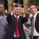 Secret Service Agents Thomas Barnes (Dennis Quaid, center) and Kent Taylor (Matthew Fox, right) look at video footage shot by an American tourist, Howard Lewis (Forest Whitaker, left), in Columbia Pictures' Vantage Point.  The film is directed by Pe