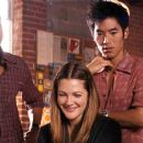 (L-r) WILSON CRUZ as Nathan, DREW BARRYMORE as Mary, LEONARDO NAM as Joshua and ROD KELLER as Bruce in New Line Cinema's romantic comedy 'He's Just Not That Into You,' a Warner Bros. Pictures release. Photo Courtesy of New Line Cinema - 454 x 188