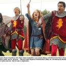 Susan (Faune Chambers, left), Peter (Adam Campbell), Lucy (Jayma Mays), and Edward (Kal Penn) charge into battle. Photo credit: John P. Johnson - 454 x 359