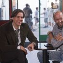"(L-r) JIM CARREY goes over a scene with director PEYTON REED on the set of Warner Bros. Pictures' and Village Roadshow's comedy ""Yes Man,"" distributed by Warner Bros. Pictures. Photo by Melissa Moseley - 454 x 303"