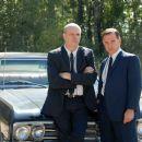 Rick Overton and Peter Scolari as FBI agents.