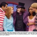 Chocolatier Willy (Crispin Glover) temporarily enchants not-so-young orphans, from left, Edward (Kal Penn), Lucy (Jayma Mays), Susan (Faune Chambers) and Peter (Adam Campbell). Photo credit: John P. Johnson - 454 x 359