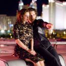 """Huck Cheever (Eric Bana) and Billie Offer (Drew Barrymore) watch the fountains of the Bellagio from a neighboring rooftop in Warner Bros. Pictures' and Village Roadshow Pictures' """"Lucky You."""" The film also stars Robert Duvall. Phot"""