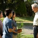(L-r) Vu (BROOKE CHIA THAO), Thao (BEE VANG), Sue (AHNEY HER) and Walt Kowalski (CLINT EASTWOOD) in Warner Bros. Pictures' and Village Roadshow Pictures' drama 'Gran Torino,' distributed by Warner Bros. Pictures. Photo by Anthony Michael R - 454 x 303