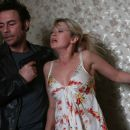 Jean-Claude Van Damme as Anthony Stowe and Michal Yannai as Jessika in Until Death.