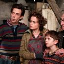 """L-r: NOAH TAYLOR as Father Bucket; HELENA BONHAM CARTER as Mother Bucket; FREDDIE HIGHMORE as Charlie Bucket and DAVID KELLY as Grandpa Joe in Warner Bros. Pictures' fantasy adventure """"Charlie and the Chocolate Factory,"""" starring Johnny"""