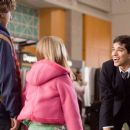 Brother and sister Spencer and Katherine (DYLLAN CHRISTOPHER and DOMINIQUE SALDANA) are placed in the care of airport attendant Zach Van Bourke (WILMER VALDERRAMA) in a scene from Warner Bros. Pictures' and Village Roadshow Pictures' comedy &#