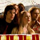 Left to right: (front) Jim Sturgess as Jude, Evan Rachel Wood as Lucy, Joe Anderson as Max; (rear) Dana Fuchs as Sadie, Martin Luther McCoy as Jo-Jo, Ekaterina Sknarina as Rita, and T.V. Carpio as Prudence in Revolution Studios' Across the Universe. - 454 x 193