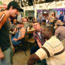 "(Left to right) Shorty (Alex Frost) celebrates with Steve Shriver (Channing Tatum) and Isaac Butler (Rob Brown), both of whom have just returned from their tour of duty in ""Stop-Loss."" Photo Credit: Frank Masi. © 2008 by PARAMOUNT PICTURES. Al - 454 x 303"