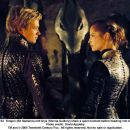 Eragon (Ed Speleers) and Arya (Sienna Guillory) share a quiet moment before heading into battle. Photo credit: David Appleby