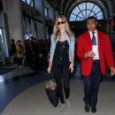 Behati Prinsloo is seen taking a flight at LAX